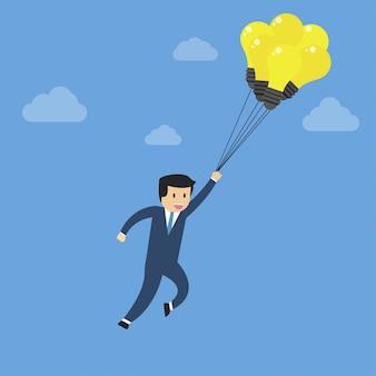 Biznesmena latanie z balonem niebo