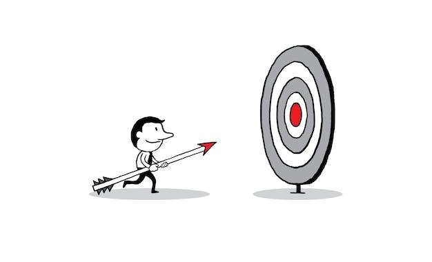 Biznesmena mienia strzała i odprowadzenie duży cel.