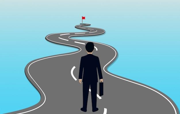 Biznesmeni idą krętą drogą