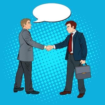 Biznesmeni pop-artu, ściskając ręce umowę biznesową.
