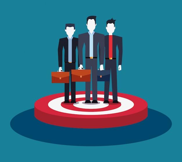 Biznesmeni zespalają się grupową pozycję na celu biznesie