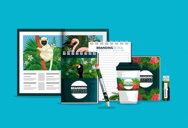 Biznesowa broszura z plastikową filiżanką i książkami z tropikalnym projektem