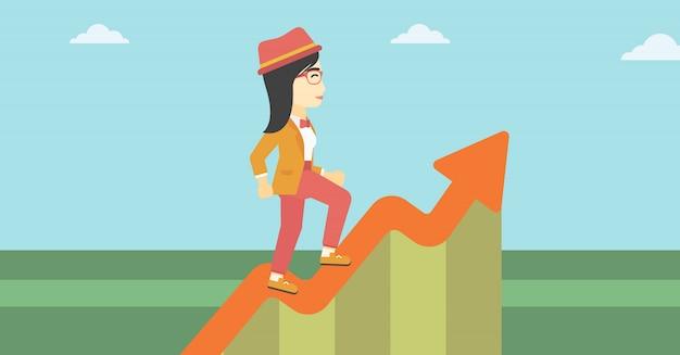 Biznesowa kobieta biega wzdłuż wzrostowego wykresu