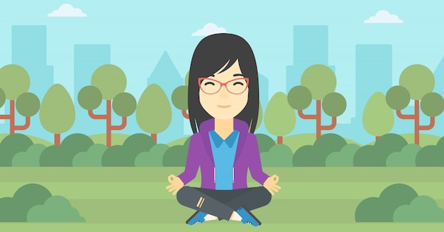 Biznesowa kobieta medytuje w lotosowej pozyci.
