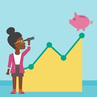 Biznesowa kobieta patrzeje prosiątko banka.