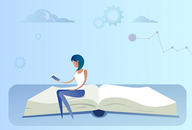 Biznesowej kobiety obsiadanie przy otwartej książki czytelniczym edukaci pojęciem