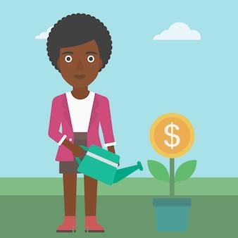 Biznesowej kobiety podlewania pieniądze kwiat.