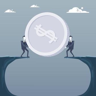 Biznesowi mężczyzna daje monecie nad falezą