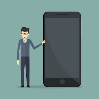 Biznesowy mówca w mobilnej technologii wskazuje przy telefonem komórkowym