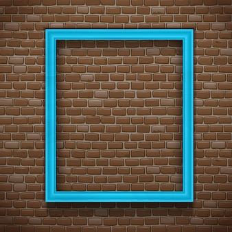 Błękit pusta obrazek rama na ściana z cegieł tle
