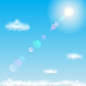 Błękitne niebo, słońce, flara obiektywu i chmury