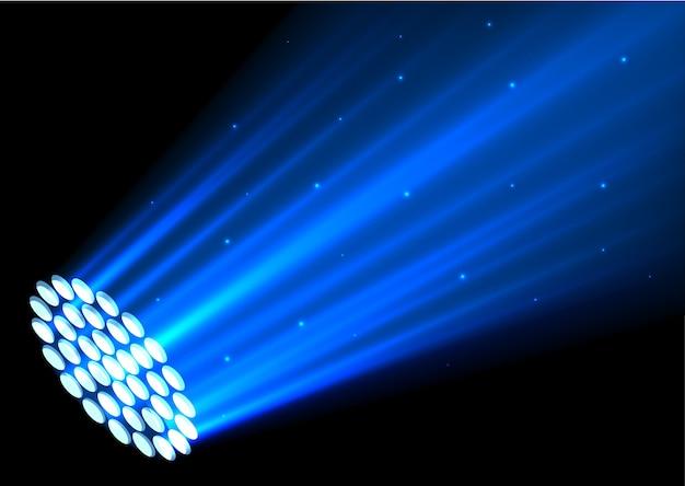 Błękitni światła reflektorów na ciemnym tle