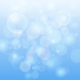 Błękitny bokeh abstrakta światła tło