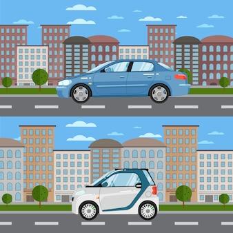 Błękitny sedan i biały mądrze samochód na drodze w mieście