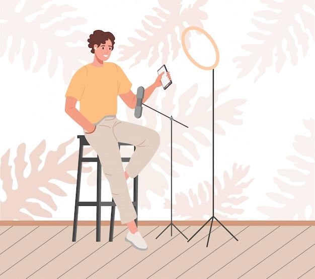 Blogger lub vlogger kreskówka mężczyzna robi płaską ilustrację treści internetowych. postać influencer tworząca wideo do recenzji bloga lub vloga