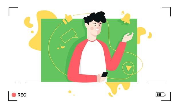 Blogger nagrywa wideo trzymając smartfon z notatkami na zielonym ekranie.