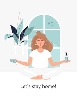 Blond kobieta siedzi w pozycji lotosu w domu z maską, środkiem dezynfekującym i tekstem zostańmy w domu!