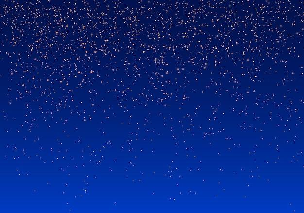 Błyszczące drobinki złota mienią się. złoty, lśniący magiczny pył. efekt świetlny na niebieskim tle. iskry i gwiazdy świecą specjalnym światłem.