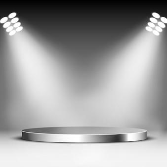 Błyszczące podium i reflektory. okrągły cokół metalowy. scena. ilustracja.
