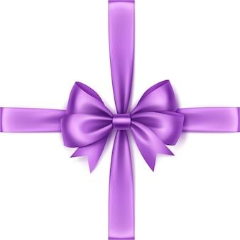 Błyszczące światło fioletowe liliowy satynowy łuk i wstążka widok z góry bliska na białym tle