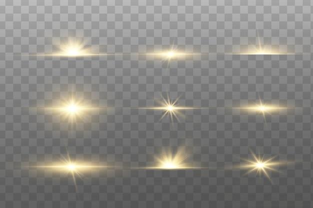 Błyszczące złote gwiazdy na białym tle.