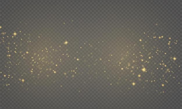 Błyszczące złote magiczne drobinki kurzu mienią się jasnożółtymi iskierkami gwiazda połyskuje świąteczny blask spark