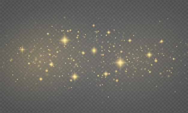Błyszczące złote magiczne drobinki kurzu mienią się jasnożółtymi iskierkami gwiazda połyskuje świąteczny blask