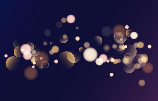 Błyszczący bokeh na białym tle na czarnym tle złote światła olśniewają świąteczny blask