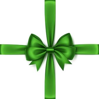 Błyszczący zielony satynowy łuk i widok z góry wstążki z bliska na białym tle