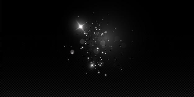 Błyszczy na przezroczystym tle. lśniące magiczne cząsteczki kurzu. iskry pyłu i złote gwiazdy świecą specjalnym światłem.