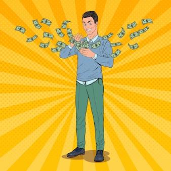 Bogaty człowiek pop-artu rzuca banknotami dolara. pomyślny biznesmen z pieniędzmi.