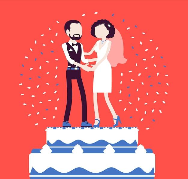 Bogaty mrożony tort weselny z panną młodą i panną młodą na wierzchu