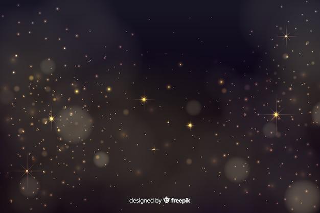 Bokeh tło z złotymi cząsteczkami