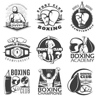 Boks czarno-białe emblematy klubów i mistrzostw z nagrodą sprzętu sportowego myśliwca na białym tle