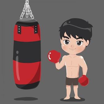 Bokser chłopiec z torbą bokserską.
