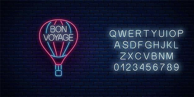 Bon voyage świecący neonowy baner ze znakiem balonu na ogrzane powietrze i tekstem. miłej podróży życzę banner z alfabetem. ilustracja wektorowa.