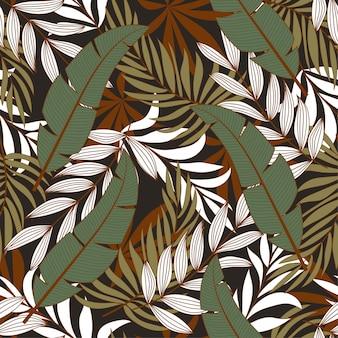 Botaniczny bezszwowy tropikalny wzór z jaskrawo zielonymi i pomarańczowymi roślinami i liśćmi