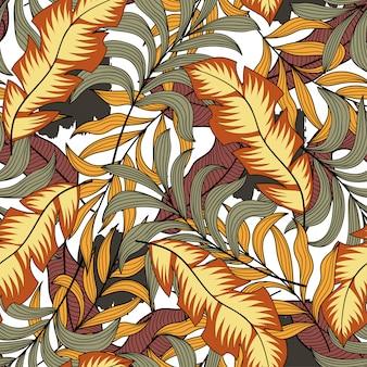 Botaniczny bezszwowy tropikalny wzór z jaskrawymi szarymi i żółtymi liśćmi i roślinami