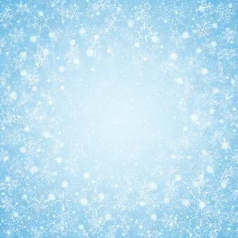 Boże narodzenia centrum niebieskiego nieba płatków śniegu deseniują tło.