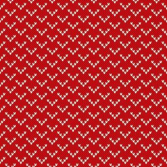 Boże narodzenie bezszwowe tło dziewiarskie. czerwony wzór z dzianiny