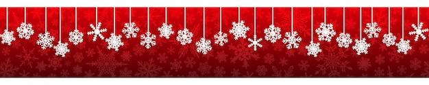 Boże narodzenie bezszwowe transparent z białymi wiszącymi płatkami śniegu z cieniami na czerwonym tle