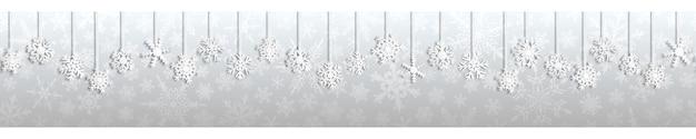 Boże narodzenie bezszwowe transparent z białymi wiszącymi płatkami śniegu z cieniami na szarym tle