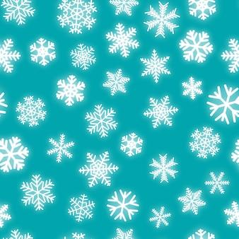 Boże narodzenie bezszwowe wzór białych płatków śniegu o różnych kształtach na turkusowym tle