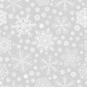 Boże narodzenie bezszwowe wzór dużych i małych płatków śniegu, biały na szarym