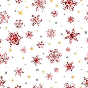 Boże narodzenie bezszwowe wzór dużych i małych płatków śniegu, czerwony na białym