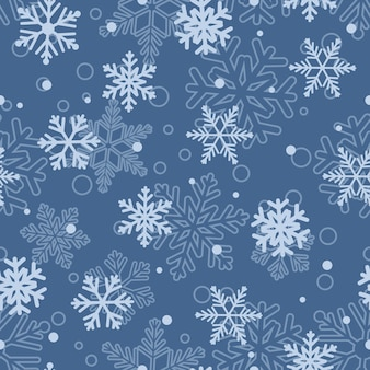 Boże narodzenie bezszwowe wzór dużych i małych płatków śniegu, jasnoniebieski na niebiesko