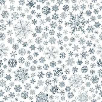 Boże narodzenie bezszwowe wzór dużych i małych płatków śniegu, niebieski na białym