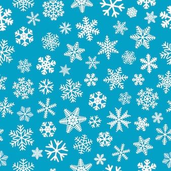 Boże narodzenie bezszwowe wzór płatków śniegu, biały na jasnoniebieskim tle