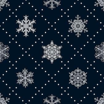 Boże narodzenie bezszwowe wzór płatków śniegu i kropek, biały na ciemnoniebieskim