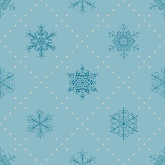 Boże narodzenie bezszwowe wzór płatków śniegu i kropek, niebieski na jasnoniebieskim
